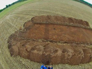 Trench 3 Road ditchcutting throughj rectangular building cutting through curved feature